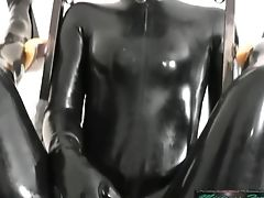 Mistress In Spandex With Two Spandex Dolls