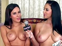 Two Black Haired Youthfull Looking Beauties With Sexy Make Up